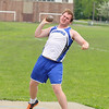 Bromfield High School sophomore Ryan Byrne competes in the shot putt at Lunenburg High School on Thursday afternoon. SENTINEL & ENTERPRISE/JOHN LOVE