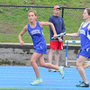 Luenburg High School freshman Hannahg Leahy hands off the baton to teammate Haley McKanzie as they competein the 4x800 at Lunenburg High School on Thursday afternoon. SENTINEL & ENTERPRISE/JOHN LOVE