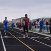 FHS's Patrick Chavis crossing in 1st of the Boys 400m