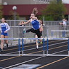 Lindsy Schuler over the last hurdle to take 1st in the Girls 300m hurdles