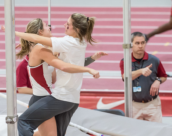 Alexis Weeks gets a hug from twin sister Victoria Weeks after Alexis cleared 4.60 meters (15 ft 1 in) during the Tyson Invitational track meet on February 13, 2016.    (Alan Jamison, Nate Allen Sports Service)