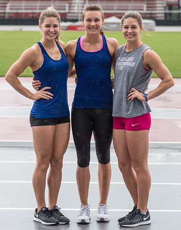 Tori Weeks, Ariel Voskamp, and Lexi Weeks in a rain delay on May 30, 2016 during a pole vault practice in preparation for the NCAA Outdoor Championship meet.  (Alan Jamison, Nate Allen Sports Service)