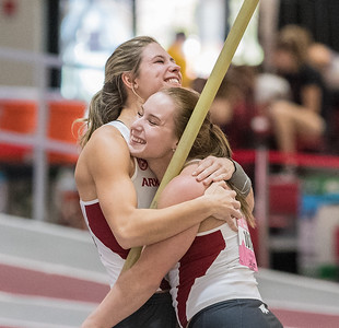 Lexi Weeks hugs teammate Desiree Freier during the Tyson Invitational Track and Field meet on Saturday, February 11, 2017.   (Alan Jamison, Nate Allen Sports Service)