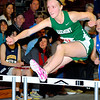 Oakmont sophomore Tess Rembetsy-Brown, 15, of Westminster participates in the hurdles race during Monday's Mid-Wach C league championships at Fitchburg High School, Monday night.<br /> SENTINEL & ENTERPRISE / BRETT CRAWFORD