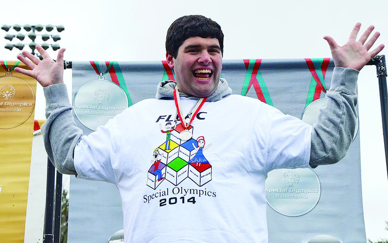 SENTINEL&ENTERPRISE/Ashley Green -- Chris Cannell, of FLLAC, proudly shows off his silver medal for the 50 meter dash during the Special Olympics North Central School Day Games on Wednesday afternoon at Elliot Field in Fitchburg.