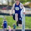 Lunenburg's Timothy Osgood competes in the long jump during the meet at Lunenburg High on Wednesday afternoon. SENTINEL & ENTERPRISE / Ashley Green