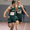 Nashoba's Zach Wright takes the baton from teammate Spencer Schryver during the 4X200 at Saturdays Mid-Wach B championship meet. SENTINEL & ENTERPRISE/JOHN LOVE