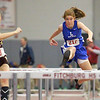 Leominster's Maggie McEvilly competes in the hurdles at the Mid-Wach A championship on Saturday in Fitchburg.  SENTINEL & ENTERPRISE/JOHN LOVE