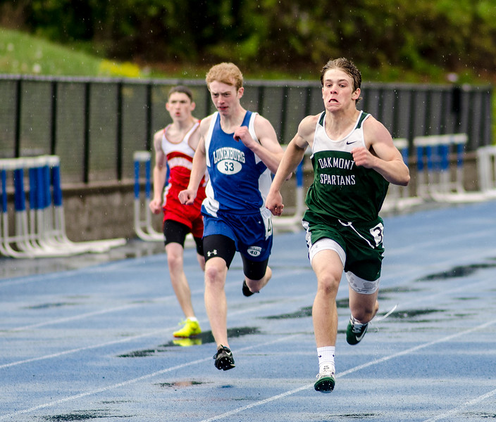 Lunenburg's Timothy Osgood and Oakmont's Jarrod Erskine run the 200 meter during the Mid-Wach C track championship on Thursday afternoon. SENTINEL & ENTERPRISE / Ashley Green
