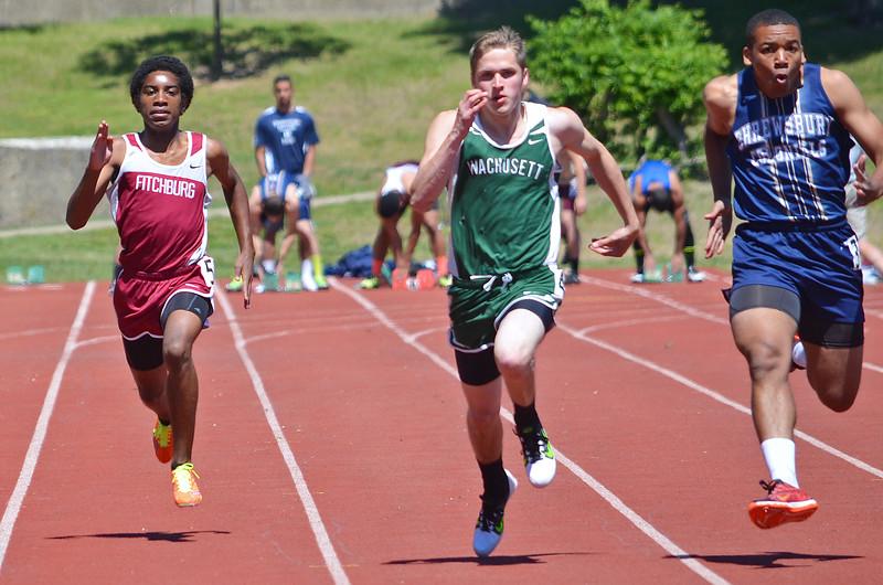 Fitchburg's Kobe Sadler runs the 100 m in the Mid-Wach A championship meet at Crocker Field on Saturday morning. SENTINEL & ENTERPRISE / Ashley Green