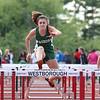 Nashoba junior Abby Slater compete in the 100 meter hurdles at their meet on Wednesday. SENTINEL & ENTERPRISE/ JOHN LOVE