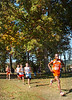 Runners exit the woods and head for the finish line during the Trailblazer CC meet at Daniel Boone High School. Photo by ned Jilton II