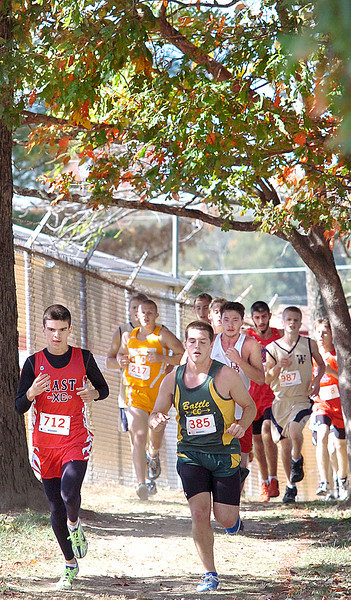 Runners make their way through the woods behind the football stadium during the Trailblazer CC meet at Daniel Boone High School. Photo by ned Jilton II