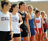 Runners line up in position while preparing to run the third leg in the Girls 4x800-meter relay during Friday's TSSAA Class AAA Section 1 Track and Field Finals at Dobyns-Bennett. Photo by Kris Wilson - kswilson@timesnews.net.