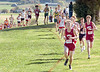 Runners make their way up hill from the lower athletic fields towards the woods during the Trailblazer CC meet. Photo by ned Jilton II
