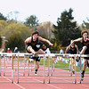 Record-Eagle/Keith King<br /> Traverse City Central's Alex Liggett, left, and teammate Aaron Taylor, right, compete in the 110-meter hurdles Wednesday, April 11, 2012 at Traverse City Central High School. Liggett finished first, and Taylor second, in the heat.