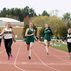 Record-Eagle/Keith King<br /> Abbey Hull, third from right, finishes first in her 100-meter dash heat Wednesday, April 11, 2012 at Traverse City Central High School.