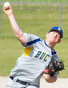 Record-Eagle/Brett A. Sommers  Buckley's Jackson Ledford releases a pitch during the opening baseball game of Monday's  doubleheader against Traverse City Christian.