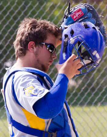 Record-Eagle/Brett A. Sommers<br /> <br /> Buckley catcher Dominique Kroskie puts on his mask during the opening baseball game of Monday's  doubleheader against Traverse City Christian.