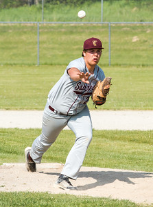 Record-Eagle/Brett A. Sommers  Traverse City Christian's Grant Maurer delivers a pitch against Buckley during the opening baseball game of Monday's  doubleheader.