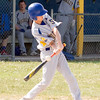 Record-Eagle/Brett A. Sommers<br /> <br /> Buckley's Trey Mori (5) swings at a pitc during the opening baseball game of Monday's  doubleheader against Traverse City Christian.