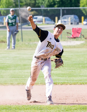 Record-Eagle/Brett A. SommersTraverse City Central's Martin Foley throws to first base during Friday's district championship game against Traverse City West at Central High School.