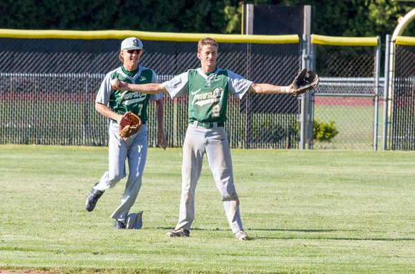 Record-Eagle/Brett A. SommersTraverse City West's Reid Bailey holds the game's final out after making a backwards falling catch during Friday's district championship game against Traverse City Central at Central High School.