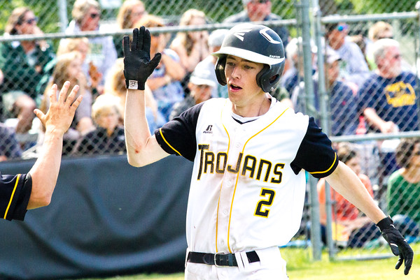 Record-Eagle/Brett A. SommersTraverse City Central's Kevin Goodwin celebrates scoring a run during Friday's district championship game against Traverse City West at Central High School.