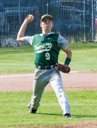 Record-Eagle/Brett A. SommersTraverse City West's Jake Newhouse to first base during Friday's district championship game against Traverse City Central at Central High School.