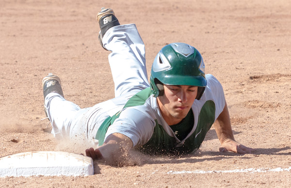 Record-Eagle/Brett A. SommersTraverse City West's Gavin Garmhausen dives back to first base during Friday's district championship game against Traverse City Central at Central High School.