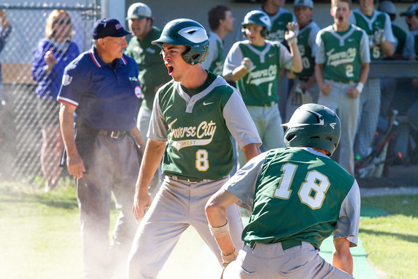 Record-Eagle/Brett A. SommersTraverse City West's Gavin Garmhausen scores the go-ahead run during Friday's district championship game against Traverse City Central at Central High School.