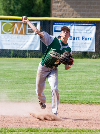Record-Eagle/Brett A. SommersTraverse City West's Reid Bailey throws to first base during Friday's district championship game against Traverse City Central at Central High School.