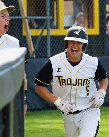 Record-Eagle/Brett A. SommersTraverse City Central's John Pupel celebrates scoring a run during Friday's district championship game against Traverse City West at Central High School.