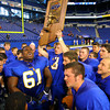 11-29-13  --  Tri-Central Football State Champions. Teammembers chant after the game around the trophy led by Darius Stanley.<br />   KT photo | Tim Bath