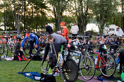Triathletes enjoy a brisk morning as they set up in transition.