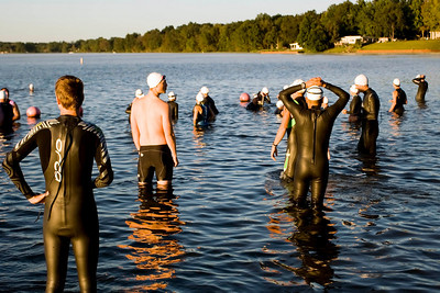 70.3 triathletes observe the daunting 1.2 mile swim that awaits them.