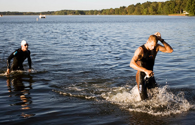 Just behind Starykowics, fellow pro triathlete Jared Woodford emerges from the 1.2 mile swim.