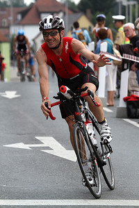 My friend Adi during his first long distance triathlon. 10h01min41s total time including time in change zone, (1h19min swim, 5h13min bike, 3h21min run) what a phantastic performance, congratulations to Ironman Adi!
