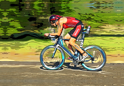 A racer speeds along during the cycling stage of the Wildflower triathlon.