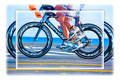 Pedaling hard during the 112-mile cycling stage of Ironman Cozumel 2013 along Playa Oriente on the east side of the island near Mezcalitos. An artistic white frame treatment has been added to this image, but otherwise it is the same as the adjacent image.