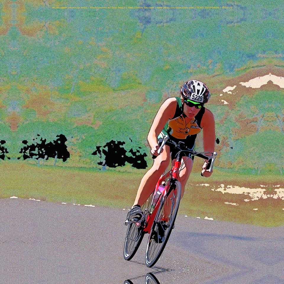 Into the Turn: a racer rounds the turn during the cycling stage of the Wildflower Triathlon.