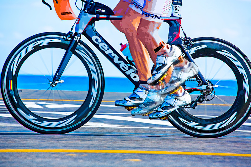 Pedaling hard during the 112-mile cycling stage of Ironman Cozumel 2013 along Playa Oriente on the east side of the island near Mezcalitos.