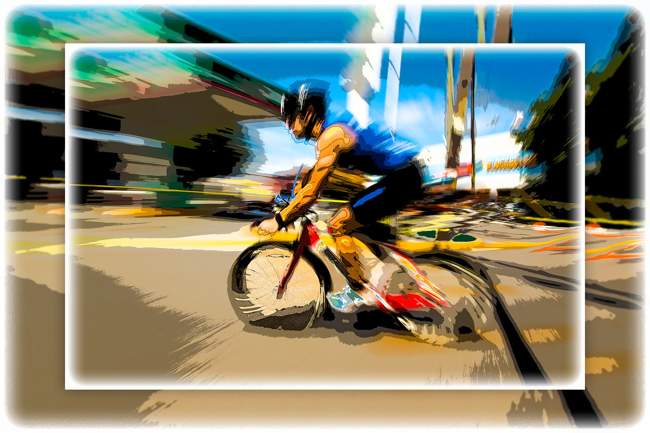 Rounding a corner and heading to the finish line of the 112-mile cycling stage of Ironman Cozumel 2013.
