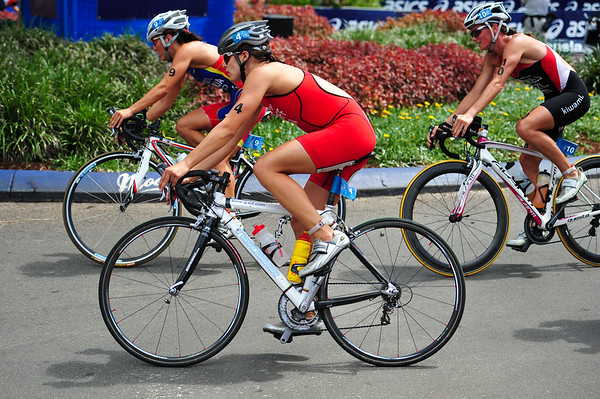 Eventual 5th place getter Sarah Groff in the bike leg (2011 winner Nicky Samuels on right) - 2010 Mooloolaba Women's ITU World Cup Triathlon, 28 March 2010.Photos by Des Thureson: http://disci.smugmug.com.