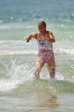 Laura Bennett is 1st to emerge from the Coral Sea - Mooloolaba Women's ITU World Cup, 28 March 2010. Photos by Des Thureson: http://disci.smugmug.com