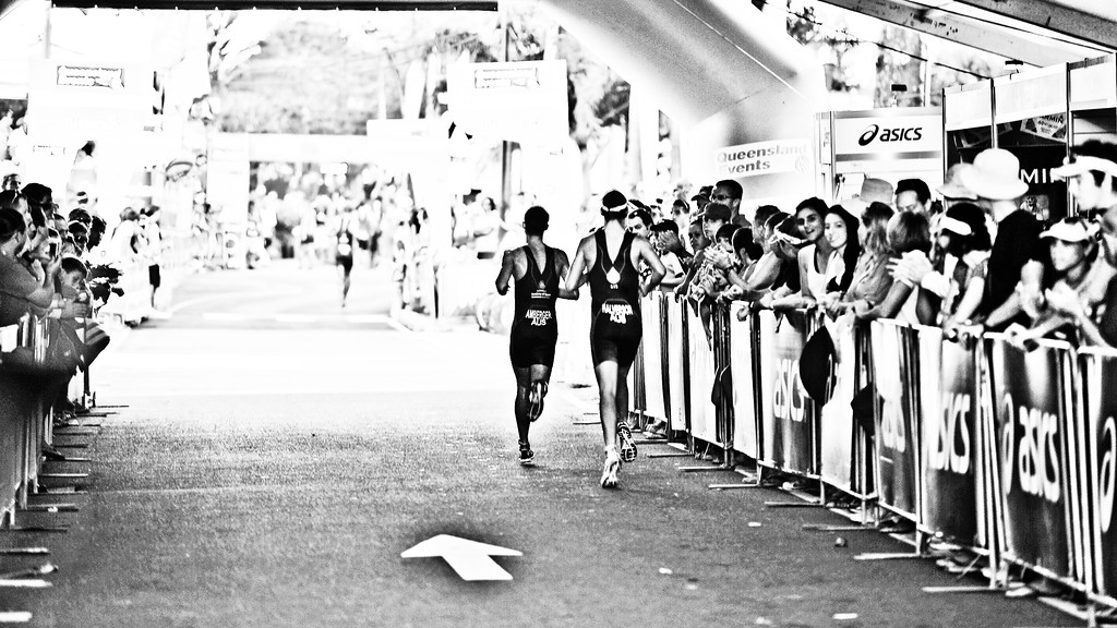 "Alternate Processing: ""X-equals + LIDF - Hardcore Acros"" - Josh Amberger & Gareth Halverson emerge from the tunnel near the finish line - 2010 Mooloolaba Men's ITU World Cup Triathlon, Sunshine Coast, Queensland, Australia; 27 March 2010. Photos by Des Thureson."
