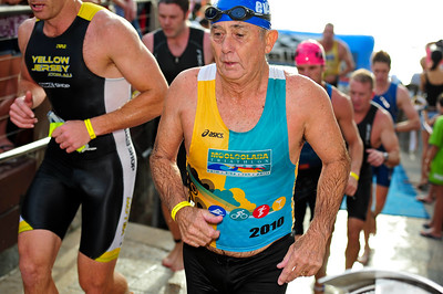 Racing up the steps from the beach to the road after the swim leg - Mooloolaba Triathlon, 28 March 2010