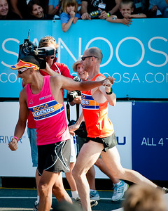 Twice Hawaii Ironman Triathlon World Champion Chis McCormack congratulates Olympic Marathon Legend Steve Moneghetti - 2011 Noosa Legends Triathlon - Super Saturday at the Noosa Triathlon Multi Sport Festival, Noosa Heads, Sunshine Coast, Queensland, Australia; 29 October 2011.