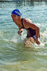 Possibly Loretta Harrop? - Exiting the Swim Leg & heading for T1 -2011 Noosa Legends Triathlon - Super Saturday at the Noosa Triathlon Multi Sport Festival, Noosa Heads, Sunshine Coast, Queensland, Australia; 29 October 2011.