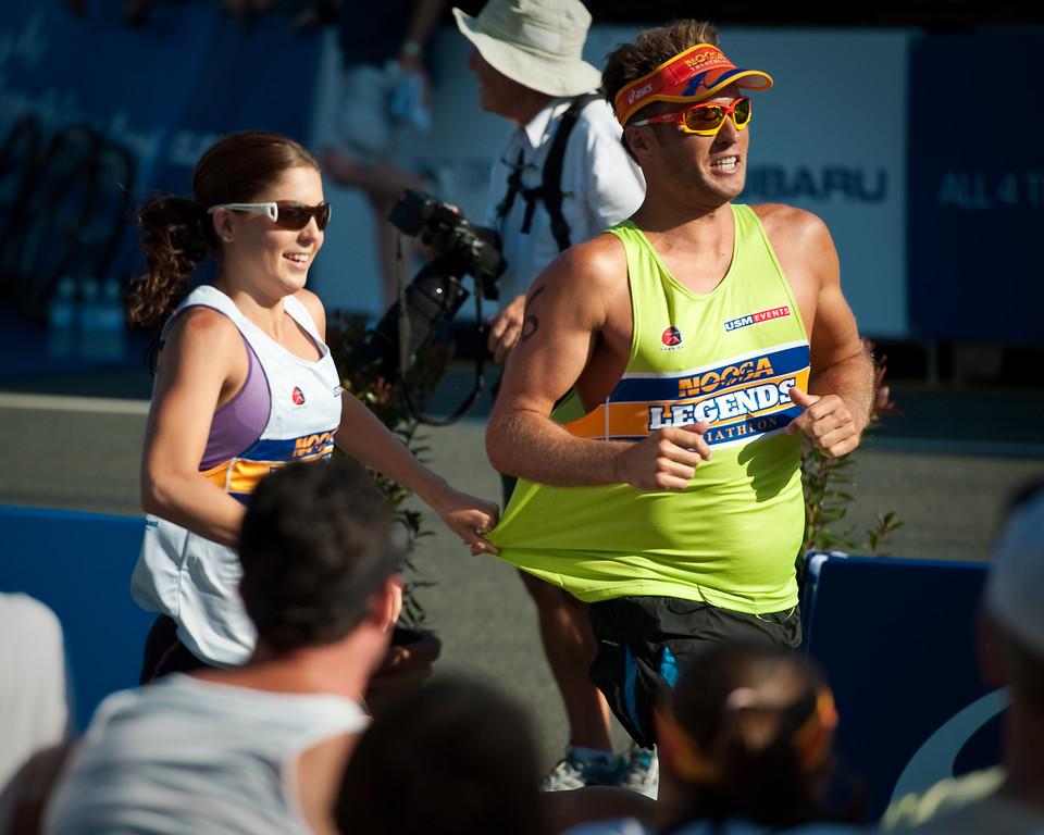 Ashleigh Gentle adds to the fun and grabs Ky Hurst's singlet - 2011 Noosa Legends Triathlon - Super Saturday at the Noosa Triathlon Multi Sport Festival, Noosa Heads, Sunshine Coast, Queensland, Australia; 29 October 2011.